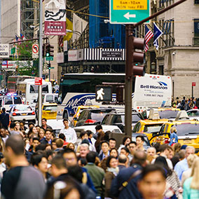 Crowds of people and traffic congest 5th Avenue, Manhattan, New York City