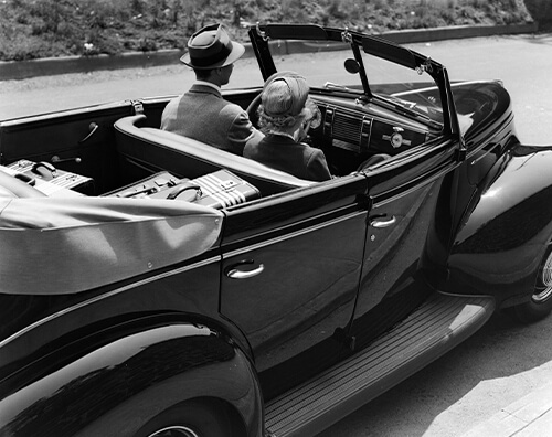 Black and white image of old vintage convertible car