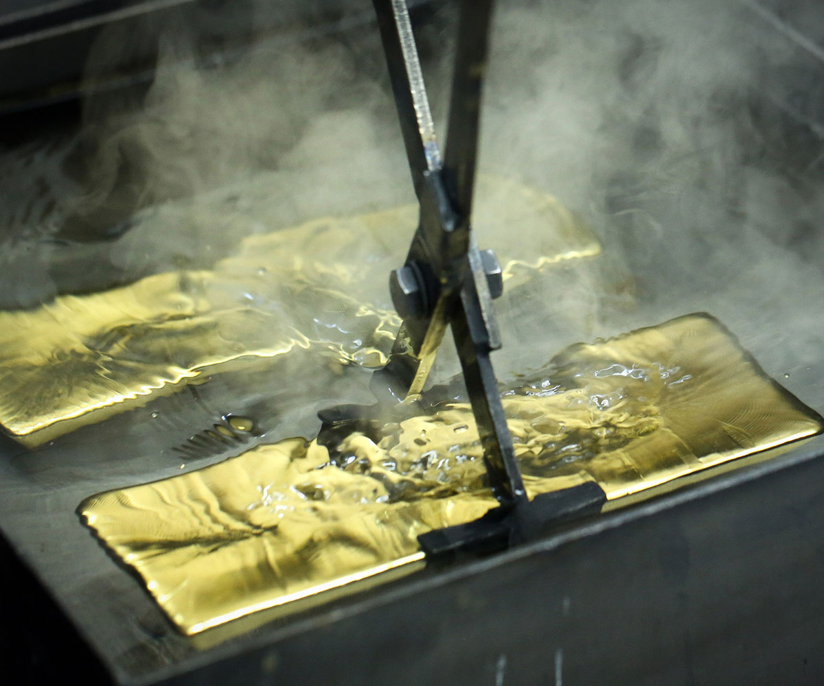 Gold bars cooling in water