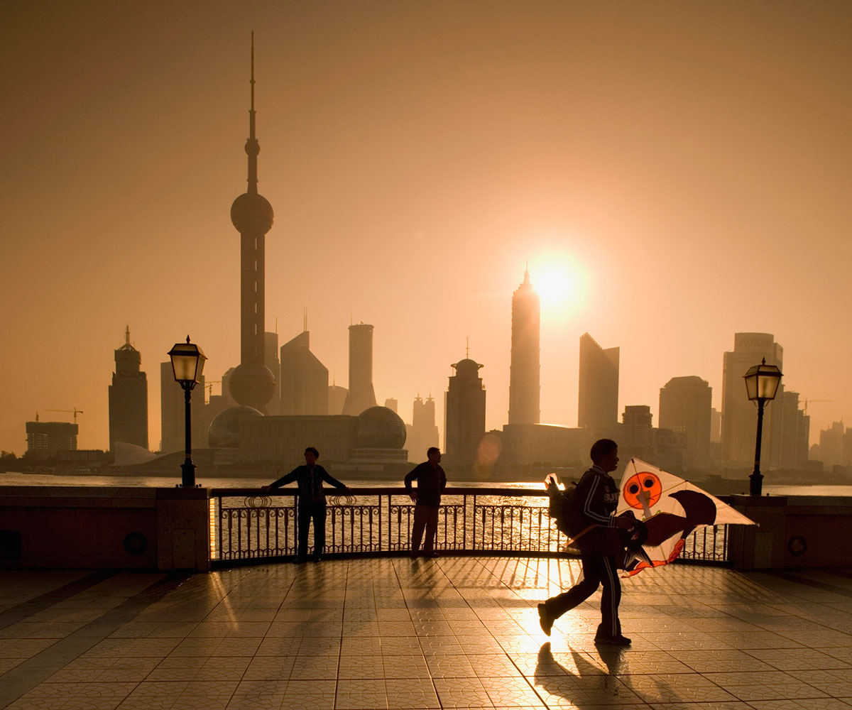 China, Shangha, Pudong, Silhouette of man with kite