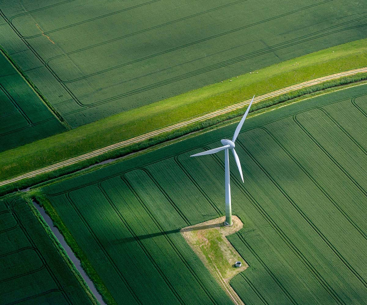 Wind turbine in green field