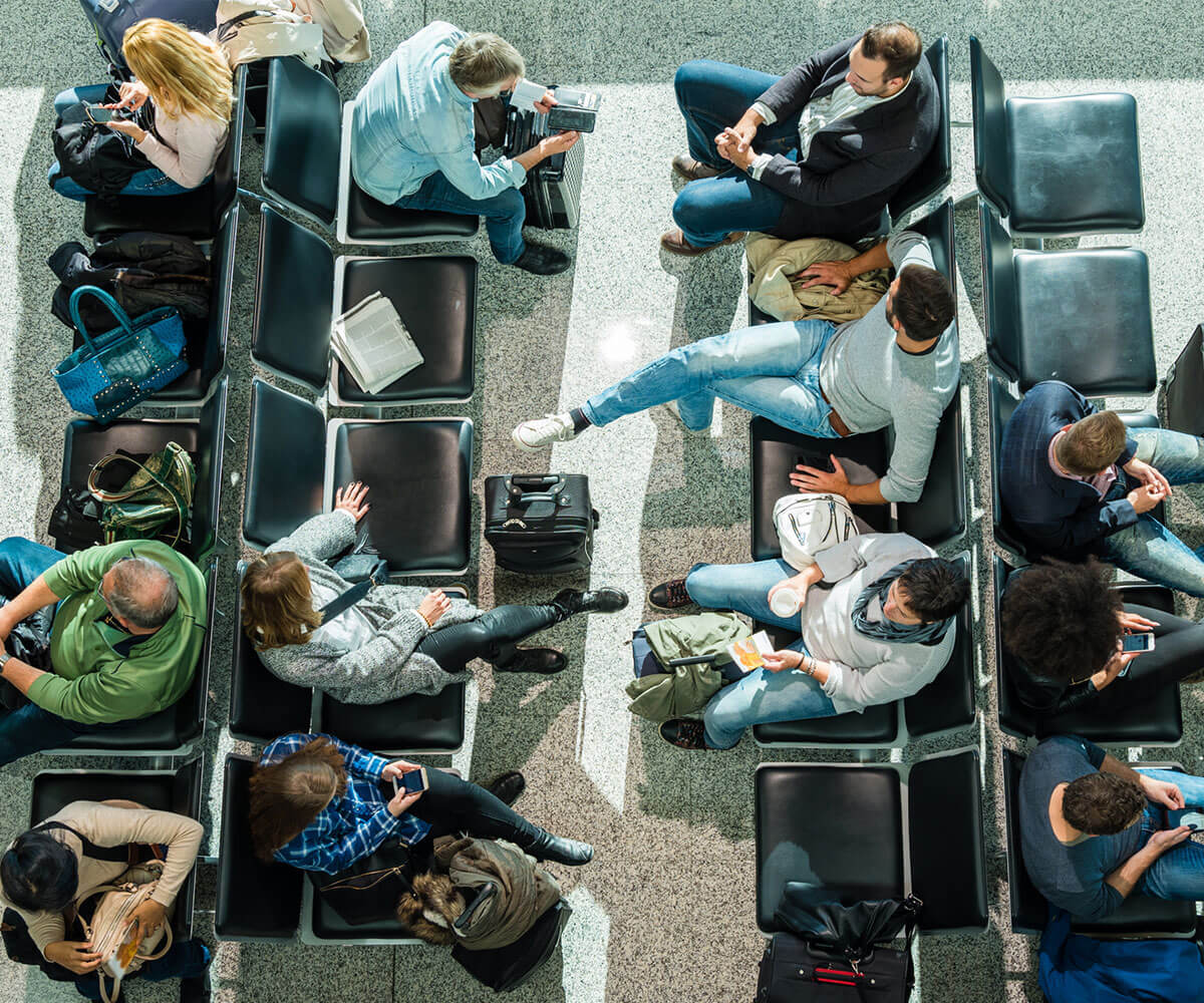 Business people waiting in airport departure lounge