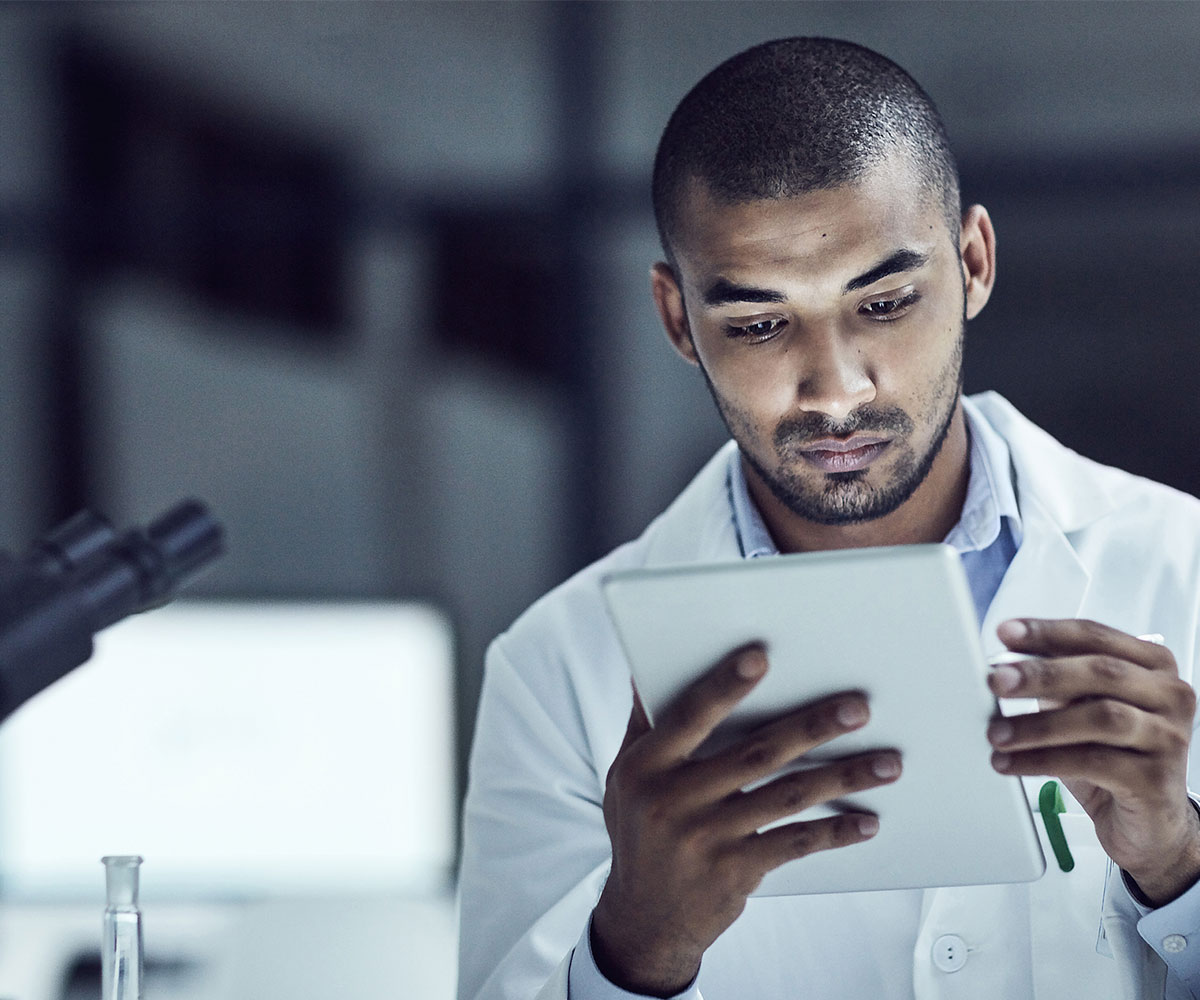 Healthcare professional reading from a tablet
