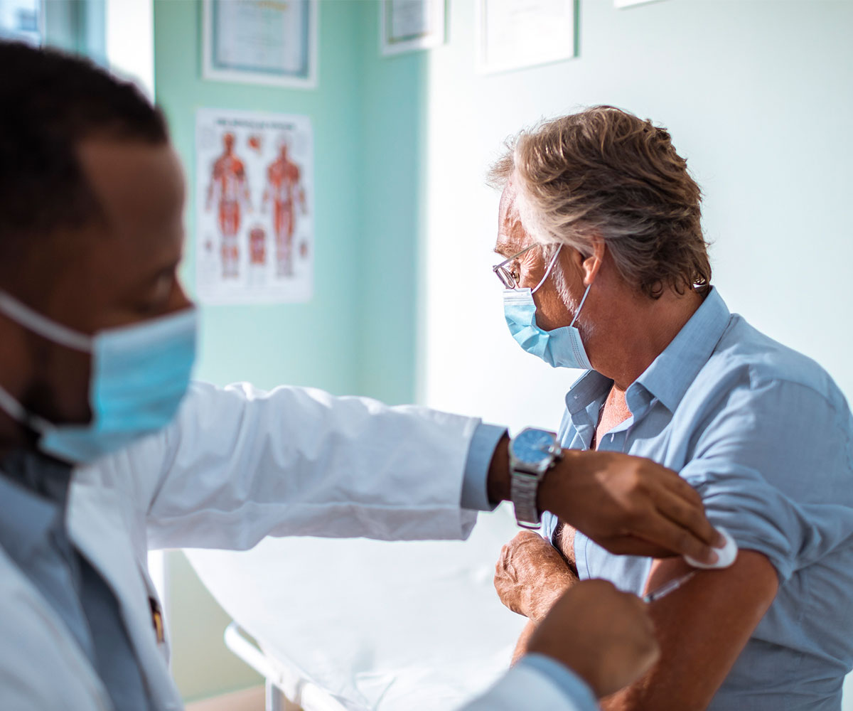 Man receiving vaccination in the arm